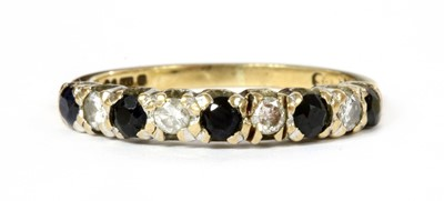 Lot 126 - A 9ct gold sapphire and diamond half eternity ring