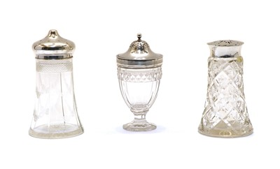 Lot 8 - Three various glass and silver topped casters