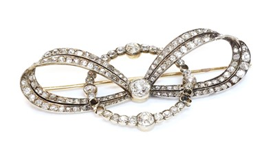 Lot 48 - A cased former Austro-Hungarian diamond set bow and hoop brooch, by Ernest Paltsho, Vienna, c.1900