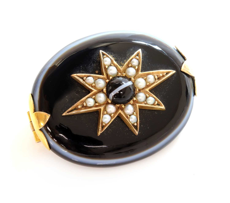 Lot 95 - A Victorian bullseye agate and split pearl star brooch