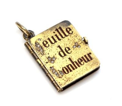 Lot 67 - An Austrian gold diamond and enamel set book form locket, c.1900