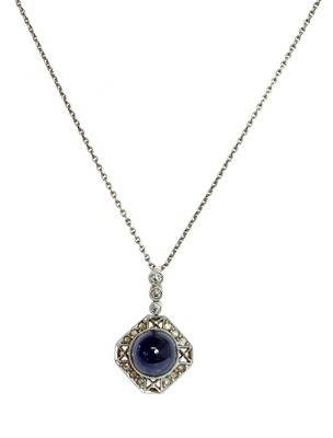 Lot 155 - A Continental Art Deco synthetic sapphire and diamond pendant