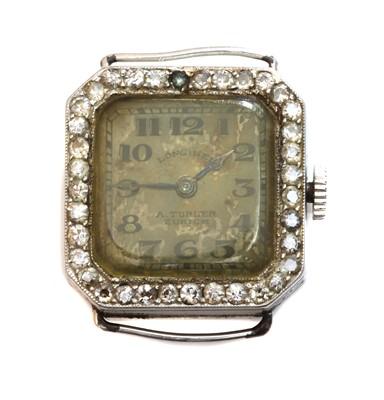 Lot 162 - A ladies' platinum and gold Longines diamond set cocktail watch, c.1925
