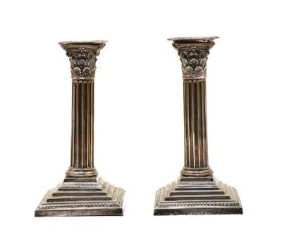 Lot 7 - A pair of silver Corinthian column candlesticks
