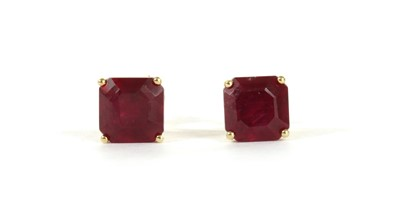 Lot 109 - A pair of gold single stone fracture filled ruby stud earrings