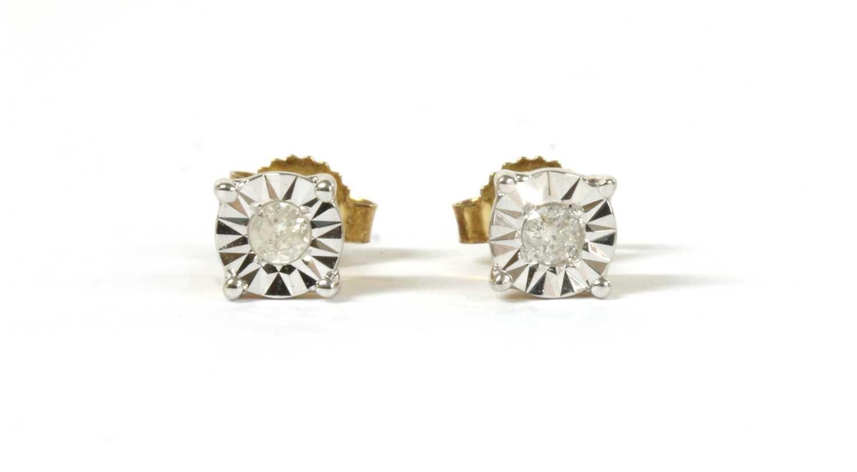 Lot 46 - A pair of gold single stone diamond stud earrings
