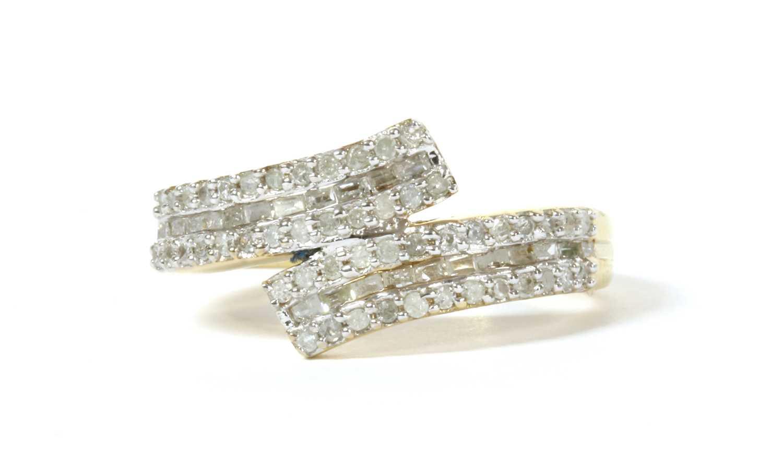 Lot 53 - A silver gilt diamond set crossover ring