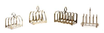 Lot 5 - Four various silver toast racks