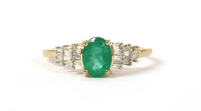 Lot 142 - A gold emerald and diamond ring