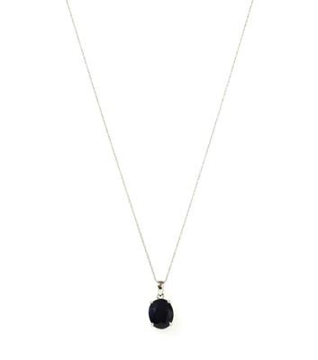 Lot 120 - A white gold single stone sapphire pendant