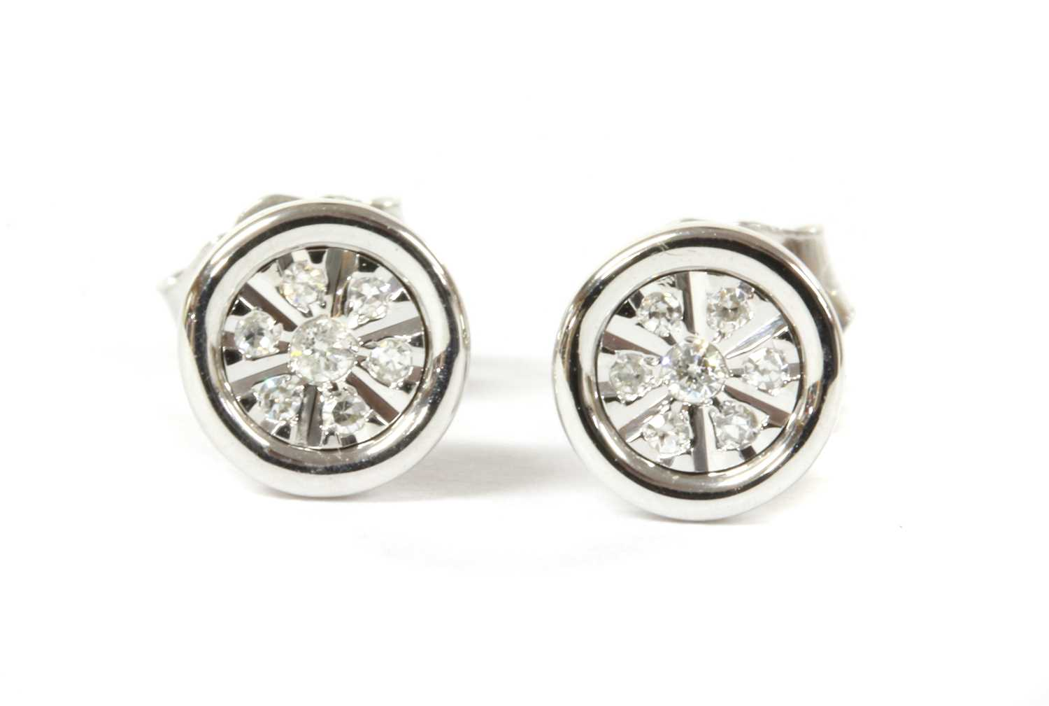 Lot 68 - A pair of white gold diamond earrings