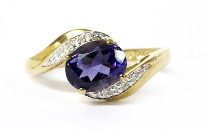 Lot 133 - A 9ct gold iolite and diamond ring