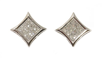 Lot 79 - A pair of 9ct white gold diamond star stud earrings