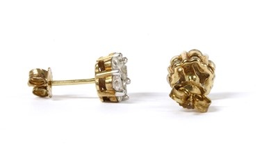 Lot 57 - A pair of gold diamond daisy cluster earrings