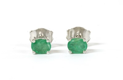 Lot 139 - A pair of white gold single stone emerald stud earrings