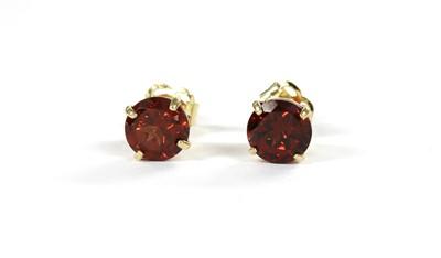 Lot 118 - A pair of gold single stone garnet stud earrings