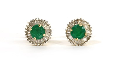 Lot 141 - A pair of gold emerald and diamond cluster stud earrings