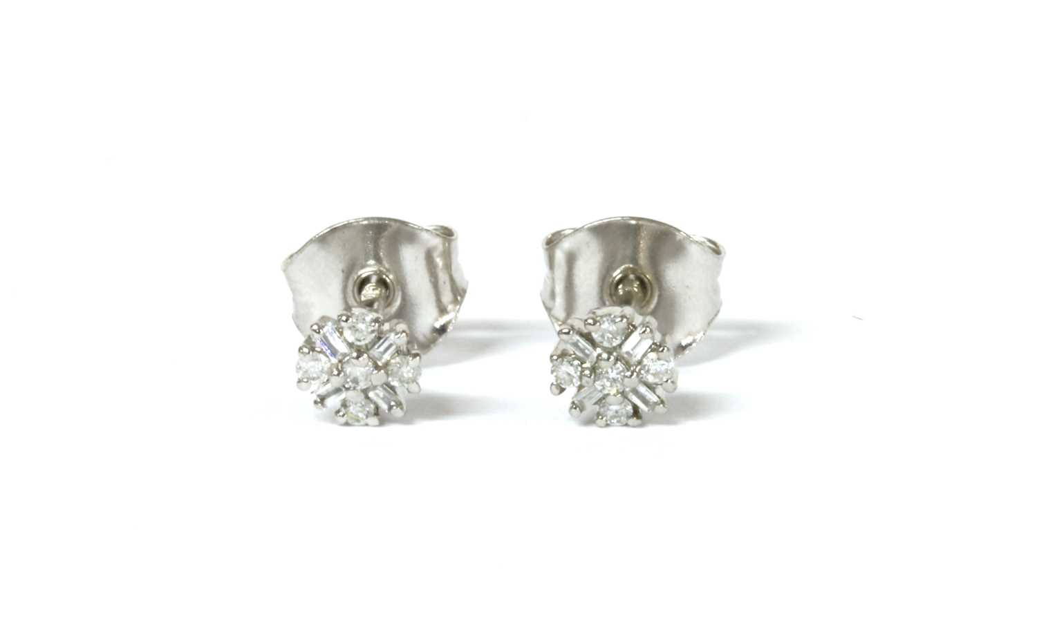 Lot 78 - A pair of white gold diamond cluster stud earrings