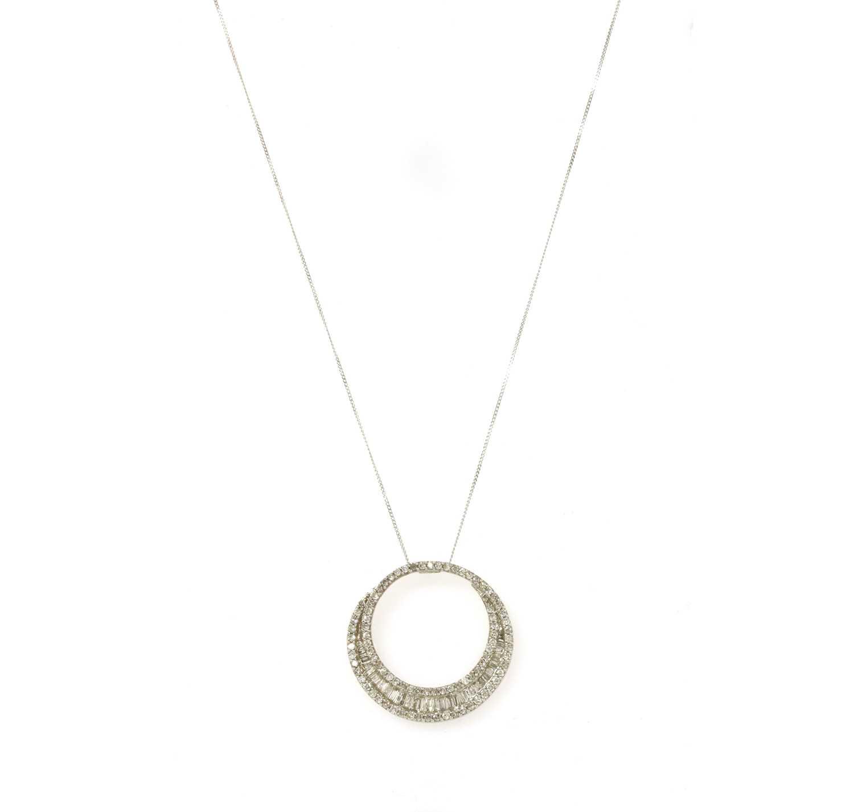 Lot 76 - A white gold diamond pendant