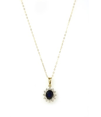 Lot 123 - A gold sapphire and diamond cluster pendant