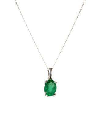 Lot 138 - A white gold single stone emerald pendant