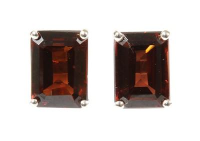 Lot 119 - A pair of white gold single stone garnet stud earrings