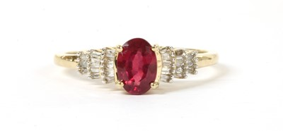 Lot 111 - A gold fracture filled ruby and diamond ring
