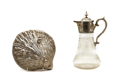 Lot 57 - A silver plated and glass claret jug and a shell box