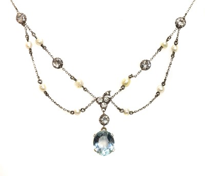 Lot 110 - An Edwardian aquamarine, diamond and pearl swag necklace, c.1910