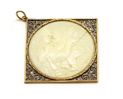 Lot 35 - A gold and silver, ivory and diamond cameo pendant