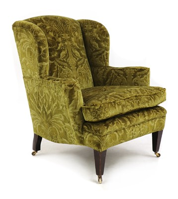 Lot 148 - A wingback armchair