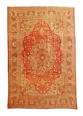 Lot 645 - A large Tabriz carpet