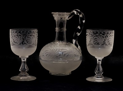 Lot 100 - An etched glass carafe and two glasses