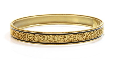 Lot 82 - A Victorian archaeological revival Etruscan style gold and enamel hinged bangle, c.1870