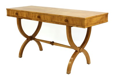 Lot An Art Deco sycamore writing table