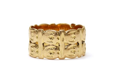 Lot 1082 - A gold two row pierced band ring