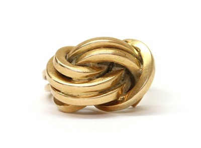 Lot 1080 - A gold knot design ring