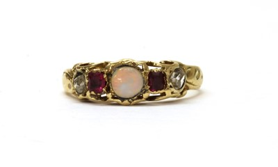 Lot 1014 - A gold opal, ruby and diamond ring
