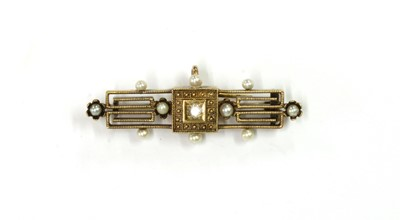 Lot 1006 - A gold Archaeological revival diamond and seed pearl brooch