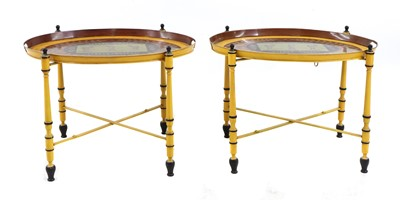 Lot 56 - A pair of Regency-style yellow-painted toleware side tables