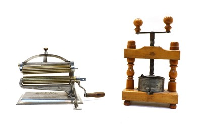 Lot 52 - An American 'Crown' pasta maker and a French wooden press