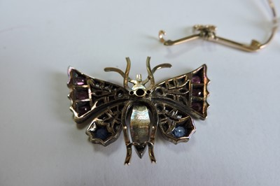 Lot 46 - A split pearl ruby, sapphire and diamond butterfly brooch, c.1900