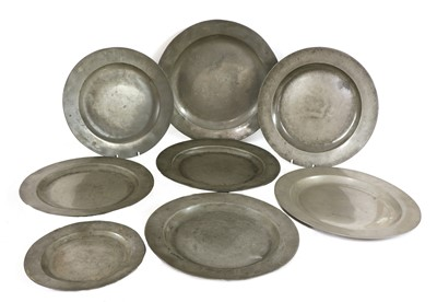 Lot 108 - Eight pewter plates