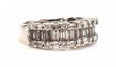 Lot 48 - An 18ct white gold diamond set half hoop ring