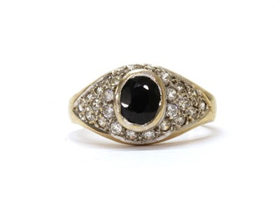 Lot 104 - A 9ct gold sapphire and cubic zirconia ring