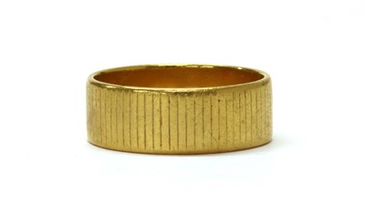 Lot 1072 - A 22ct gold flat section wedding ring