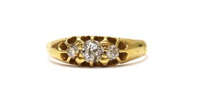 Lot 1031 - An Edwardian gold three stone diamond ring