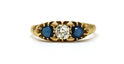 Lot 1027 - An Edwardian gold diamond and sapphire three stone ring