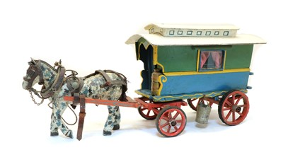 Lot 55 - A painted wooden model of a gypsy caravan and horse
