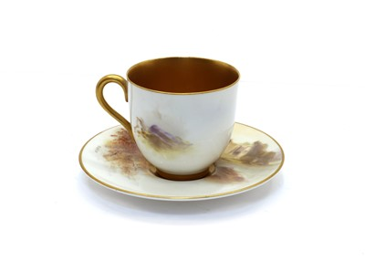 Lot 101 - A Royal Worcester porcelain cabinet cup and saucer